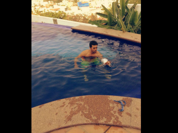 Ram Charan swim with his dog