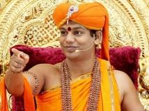 http://telugu.filmibeat.com/img/2019/08/swami-nithyananda-1566984231.jpg